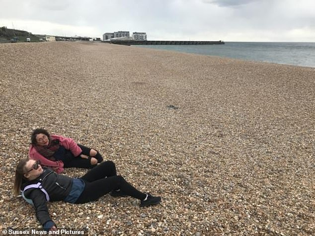 The campaigners claim that a lack of safeguarding measures means some people are able to 'get away with unwanted behaviours' which puts others off from using the beach. Pictured: Bella Kirkus and Eva Wilshere sat on the nudist beach
