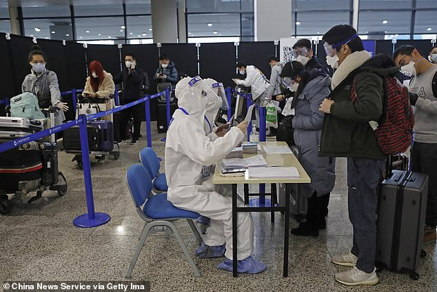 Airport security staff check information of inbound passengers at Shanghai Pudong International Airport.The Chinese government has been keeping a secret watchlist on 700 Americans, after they traveled through the airport, according to a cybersecurity group