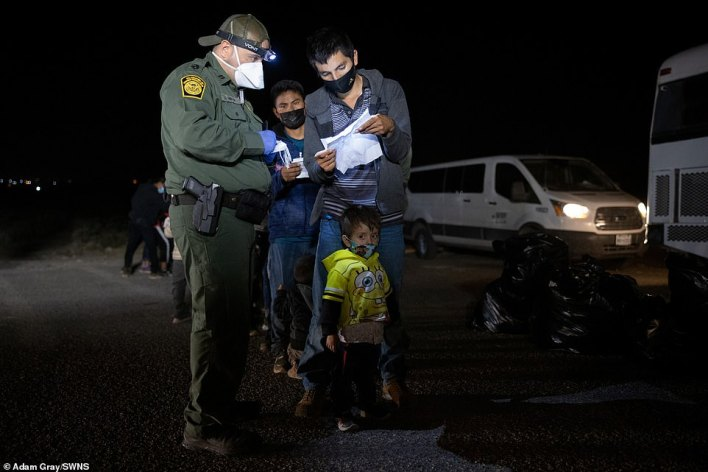 Children and babies crossed the Rio Grande overnight with their parents in small inflatable rafts to enter the country through Roma, Texas