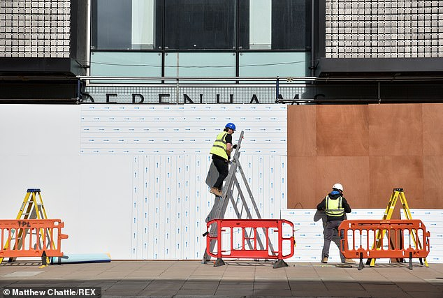 The former Debenhams flagship store on Oxford Street is boarded up by workers in a sad sight in the West End on Thursday