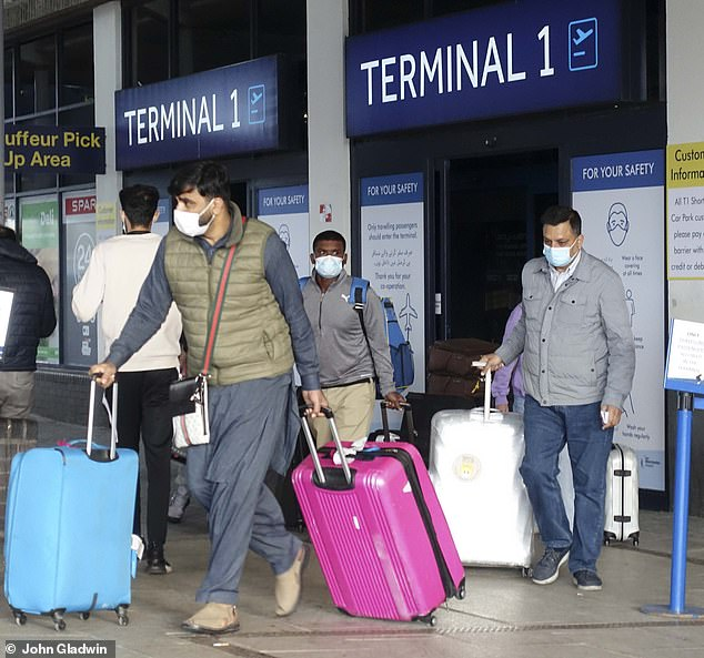 Thousands of travellers were yesterday facing a race home from Pakistan to beat today's hotel quarantine deadline. (Above, the last Pakistan flight from Islamabad, into Manchester, before the new quarantine regulations are implemented)