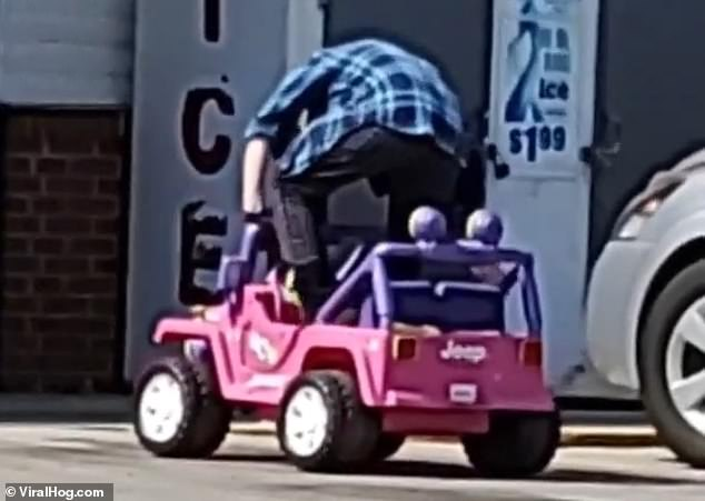 In the hilarious clip, recorded in Shell Rock, Iowa, the woman places her items from the grocery store in the trunk compartment and drives out the parking lot