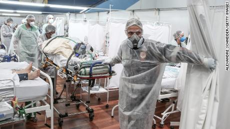 Medical staff transport a patient on a stretcher at a field hospital in Santo Andre, Brazil on March 11.