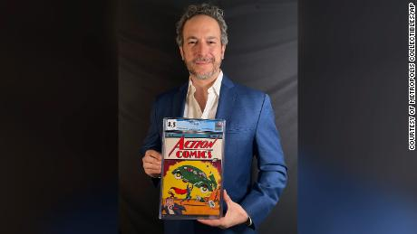Vincent Zurzolo, co-owner of ComicConnect, holding the comic book marking Superman's first appearance. It sold for an historic, record-breaking $3,250,000 this week.