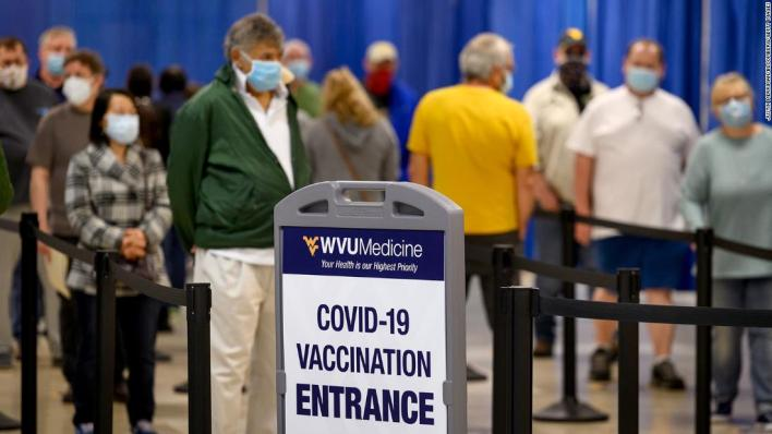 Half of US adults could have a Covid-19 vaccine dose by the weekend, but experts say it's too soon to declare victory