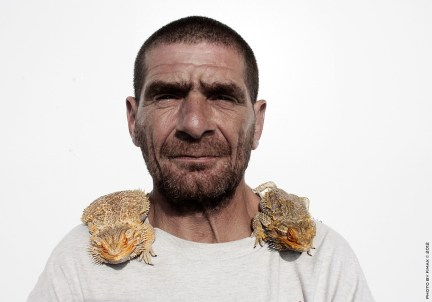 man-with-two-lizards_8222331523_l
