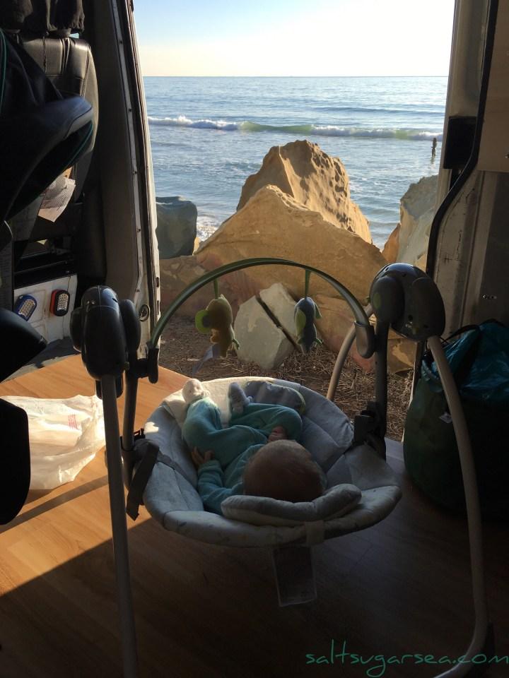baby swinging sprinter van ocean