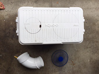 Traced holes to cut in the top of the ice chest for the diy travel Air conditioner