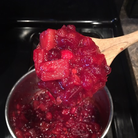 Brilliant red cranberry sauce recipe made with fresh cranberries, pineapple, and ginger
