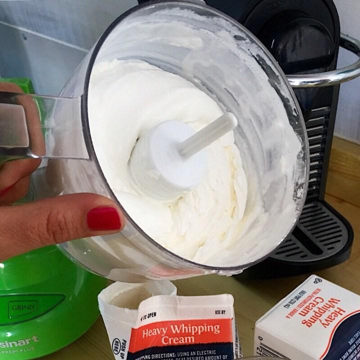 Homemade whipped cream in a blender