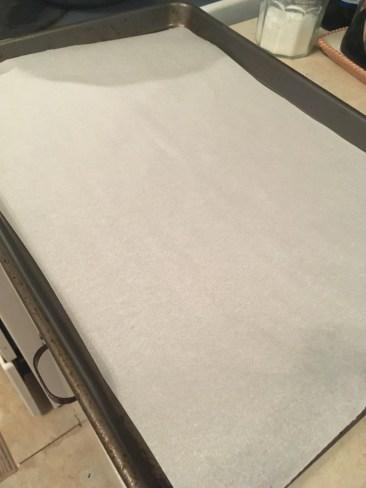 9) Place parchment paper on pan