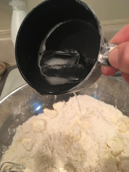 4) After the butter begins to mix into flour, and turn into smaller pieces, drizzle ice water into dough