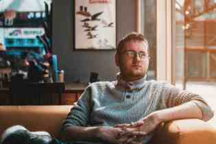 Man on sofa says more should be done