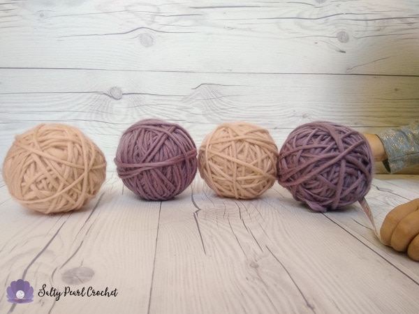Learn how you can make your own wool dryer balls with half the wool! Thrifty, environmentally friendly, and pretty to boot!