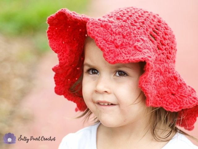 My daughter wearing her Scalloped Toddler Beach Hat on a nature walk.