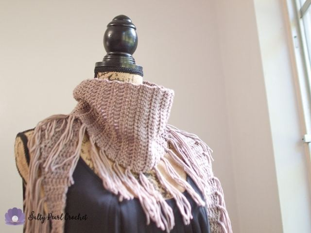 Closeup view of the triangle scarf crochet pattern showing the simple stitching and the fringe