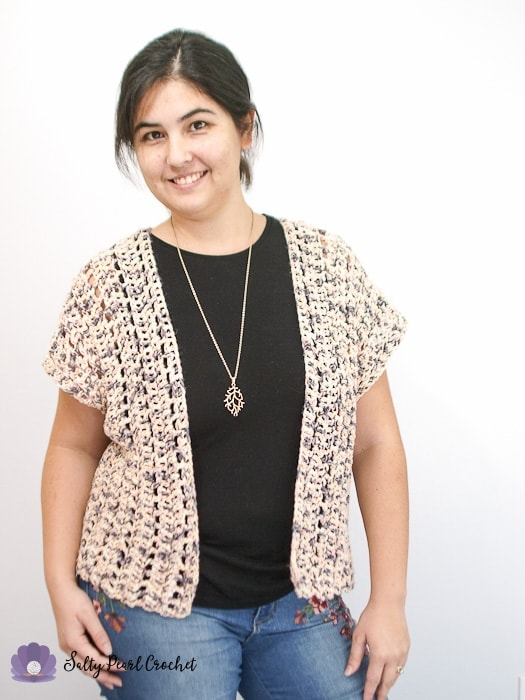 Woman wearing a sweater made from an easy crochet cardigan pattern for beginners