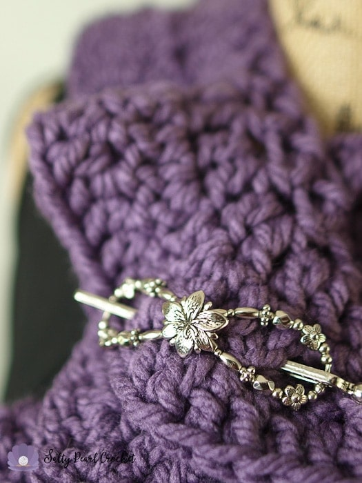 Photo of a Lilla Rose Flexi Clip used as a shawl pin on a ruffle scarf