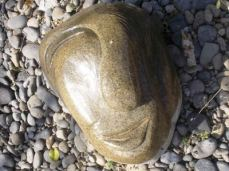 A half face of a man made from stone