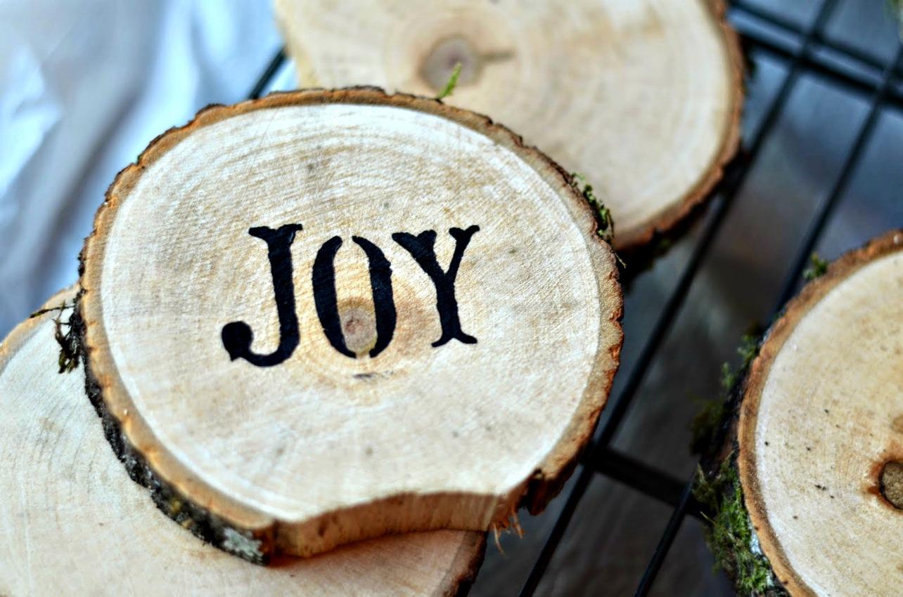 joy - stenciled diy wood beverage coasters on salvagesisterandmister.com