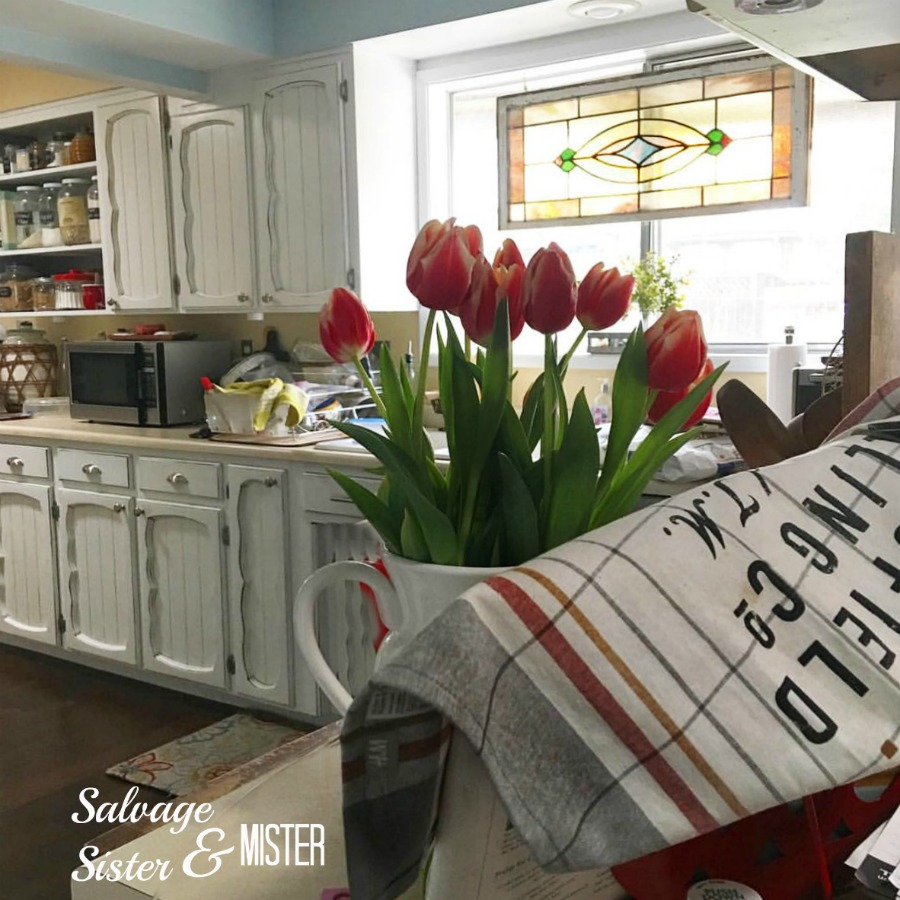 Salvaged kitchen remodel. Painted cabinets made a huge difference. A little diy and some vintage and used materials and the ktichen is updated.