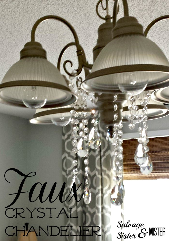Standard light fixture turned into a faux crystal chandelier. Inexpenisve light fixture idea. www.salvagesisterandmister.com