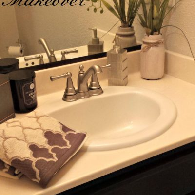 bathroom painted cabinet and mirror