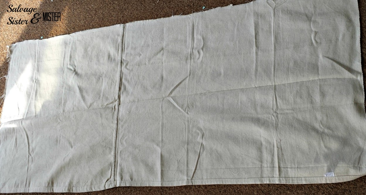 Making a grain sack table runner with leftover drop cloth material. www.salvagesisterandmister.com