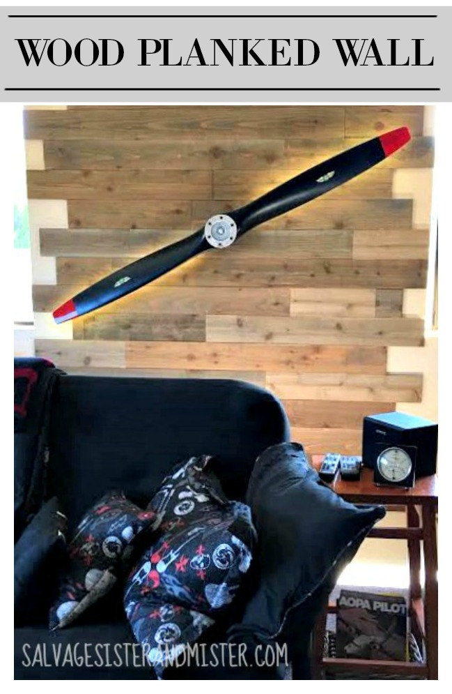 Using some new pieces of fence to create this faux reclaimed planked wall for our game room.  This now has a spinning propeller with lights.  Great for a man cave.  Get this low-cost home diy project on salvagesisterandmister.com (budget-friendly)