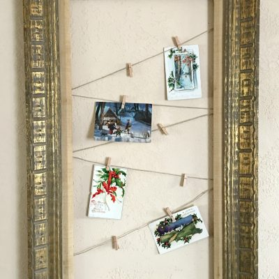 Photo or Card Display from Thrifted Picture. Great to use to display vintage postcards, Christmas cards, pictures, or use it as an advent calendar. This is an easy DIY and is a great way to use up old pictures you don't want anymore or a pretty frame from a thrift store of flea market find.