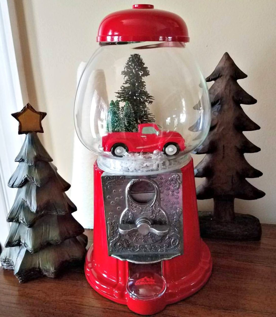 Use what you got for your Christmas decor. Get tons of upcycle christmas ideas to show your stuff in a whole new way. Budget friendly. Low cost Christmas. Junkin Gumball machine turned Christmas village.