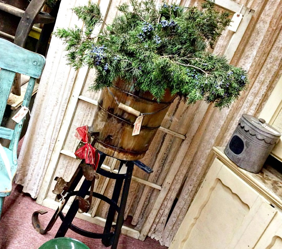 A vintage ice cream bucket is used for holiday decor. Use what you have for easy and inexpensive decorating. Upcycle Christmas ideas.