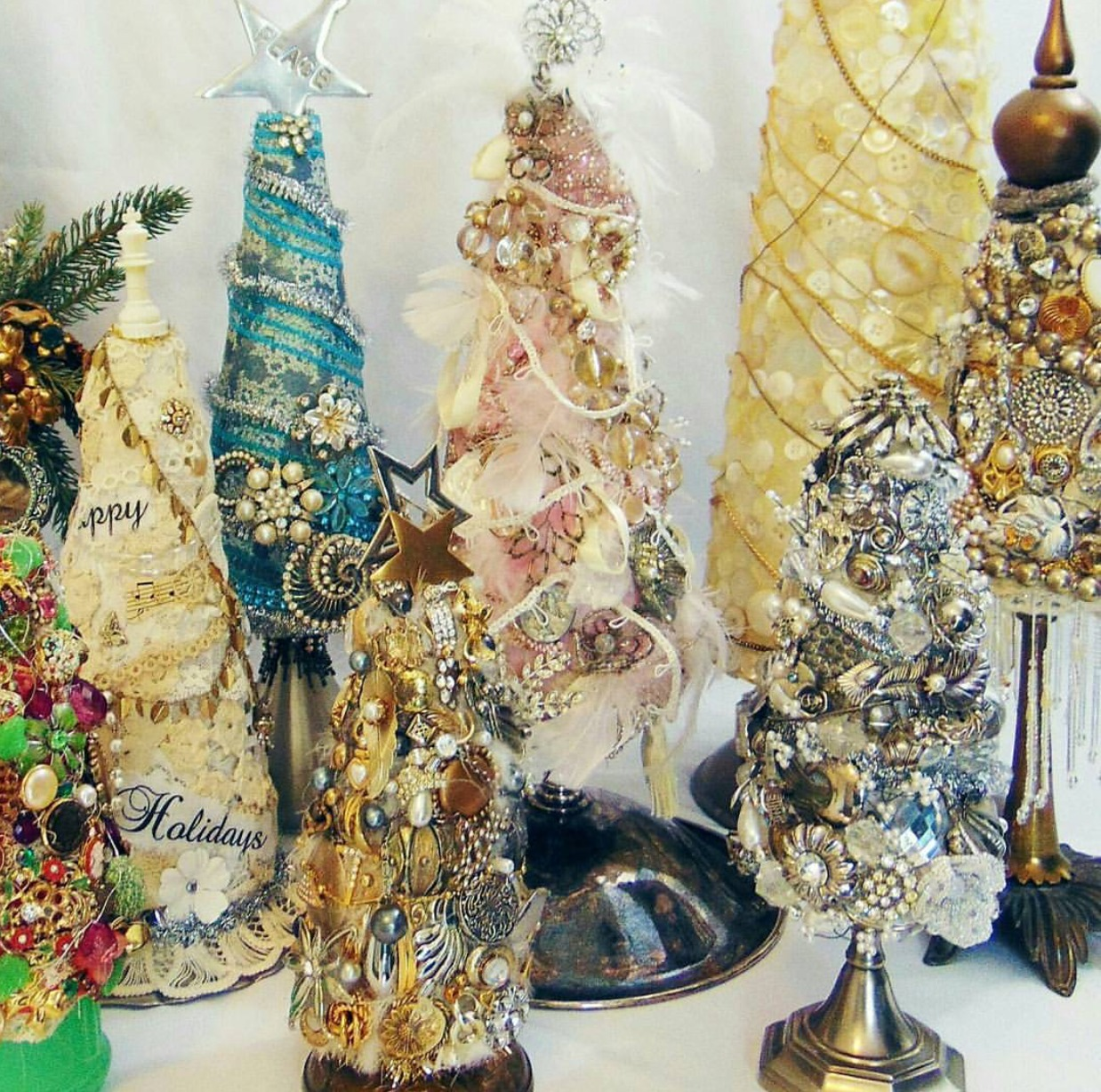 leftover jewelry, beads, ribbon, and fabric scraps make for beautiful trees.