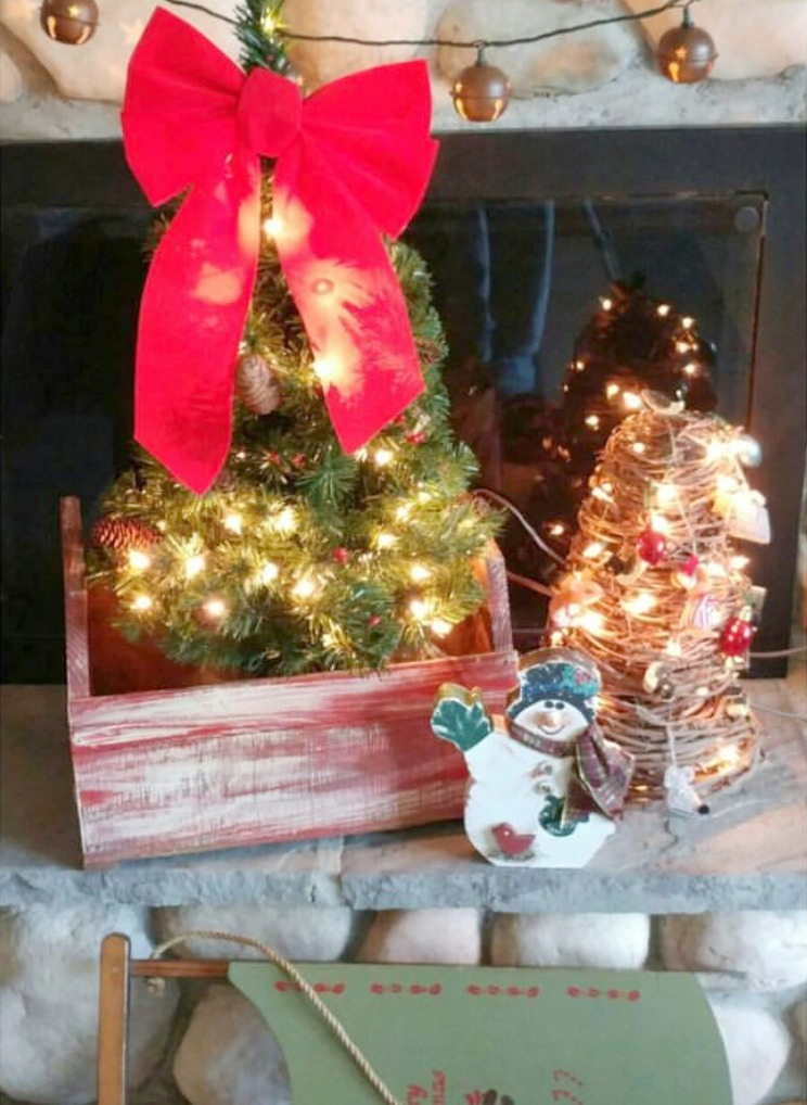 Grapevine tree made from Florida vining wrapped around a construction cone. Make the best with what you have. Lots of upcycle Christmas ideas.