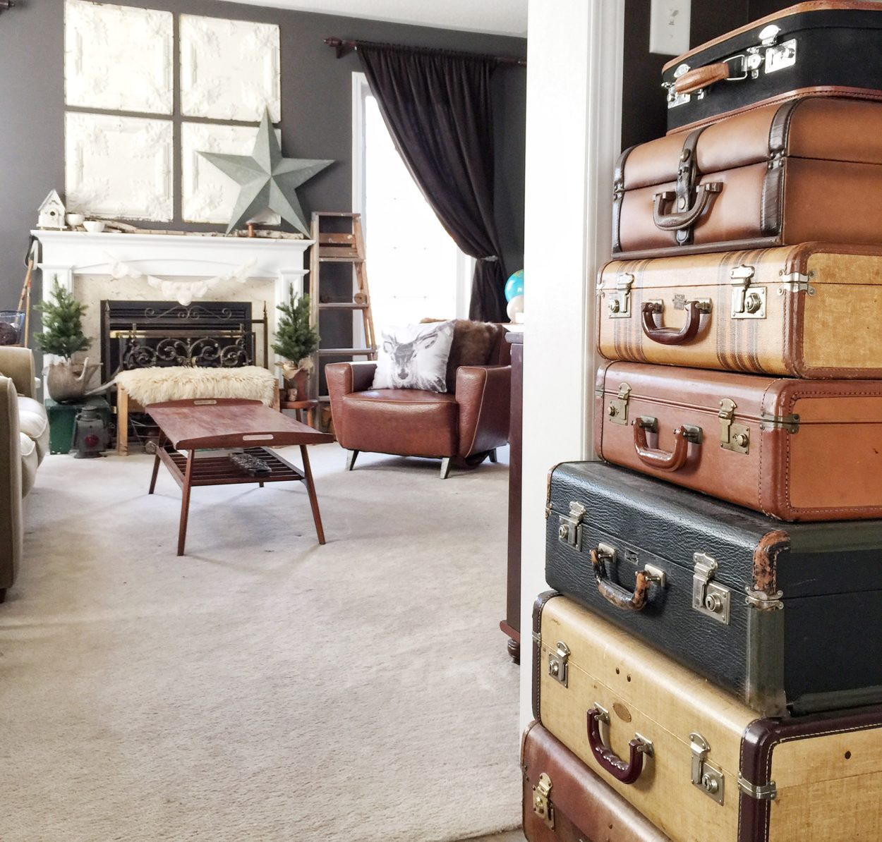 A collection of vintage suitcases is a great bargain decor item. Look for that at flea markets, thrift stores, and yard sales. Come see this vintage home tour for lots more home decor inspiration. Interior design