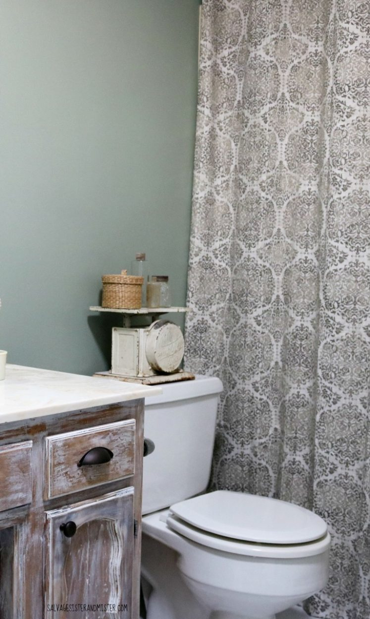 DIY low cost rustic bathroom makeover. This was part of the $100 room makeover challenge. Come see if we made our budget