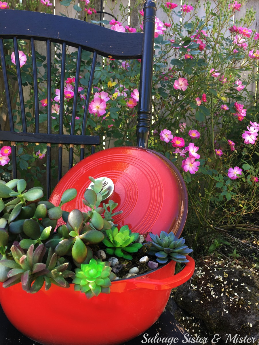 Spring and summer means garden and the great outdoors. Use items from around the home to creat a repurpose, reuse, or upcycled garden. This dutch oven succulent planter is a perfect example of planting outside the box. Use whatever you have on hand to create a colorful yard or add some curb appeal to your front porch.