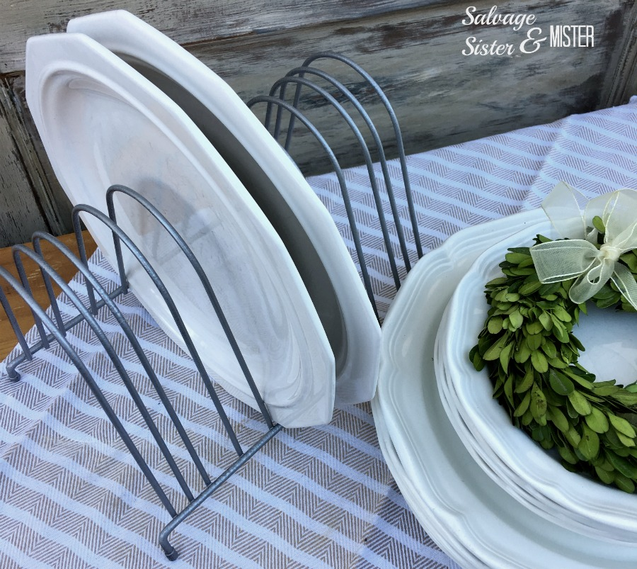 A diy chicken feeder plate rack for farmhouse decor. This trend is very popular in farmhouse decor. Upcycle or repurpose this thrifted item to be in the trend on a bargain. This low cost alternative creates less waste and still gives the same decor look.
