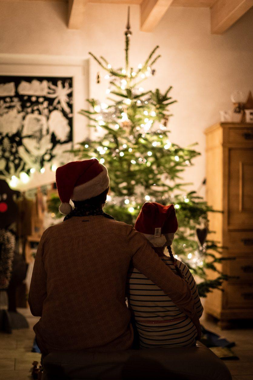 people looking at Christmas tree
