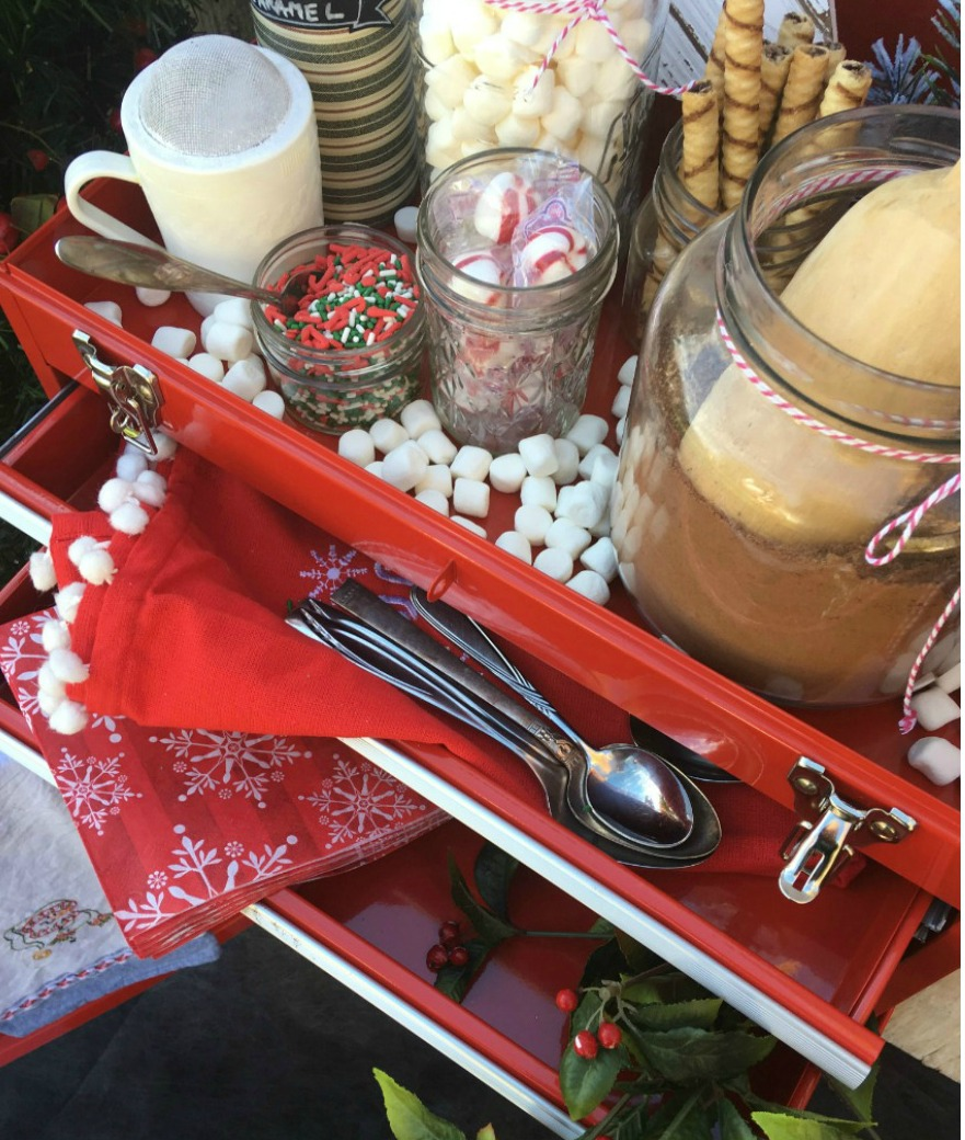 Hot cocoa station made from a tool box (cabinet) This upcycle is a fun way to upcycle something you have and make use of what you got. Fun repurpose for the holidays. Hot chocolate station.