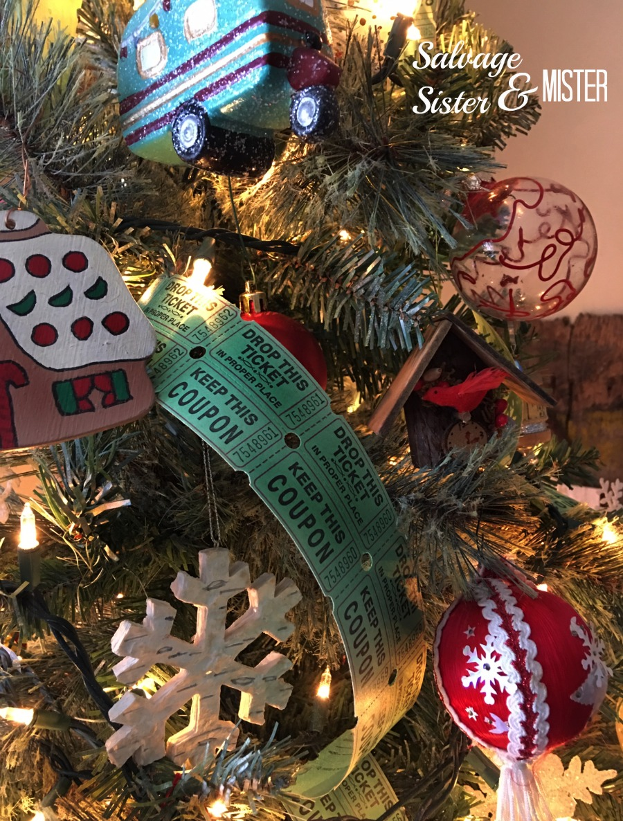 A simple vintage Chrismtas tree using thrifted items and things I already had on hand like these tickets as garland. You can upcycle items to use as holiday decor. Repurpose or reuse items in a new way. Budget decorating to make the most wiht what I have. #upcycle #christmastree