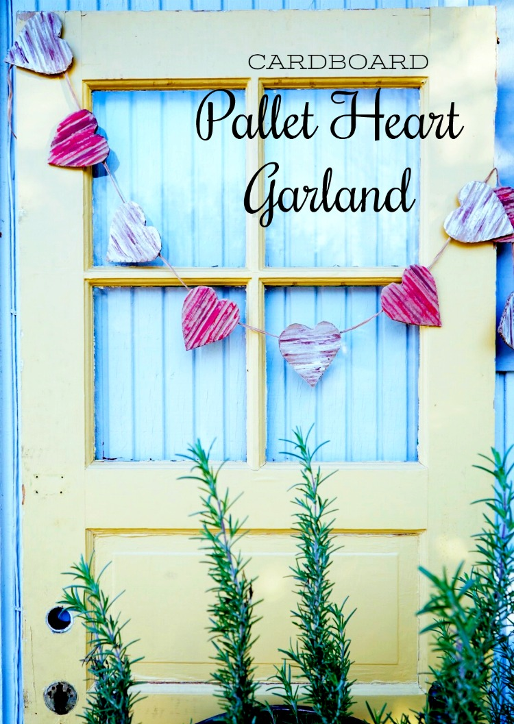 DIY cardboard pallet heart Valentine garland. This craft is easy to make with supplies on hand. Perfect way to upcycle / repurpose cardboard boxes. Holiday decor for your home.
