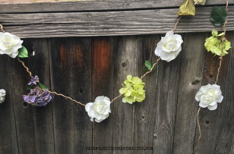 How to make an artificial flower garland using thrift store flowers. #craft #flowergarland #diy salvagesisterandmister.com