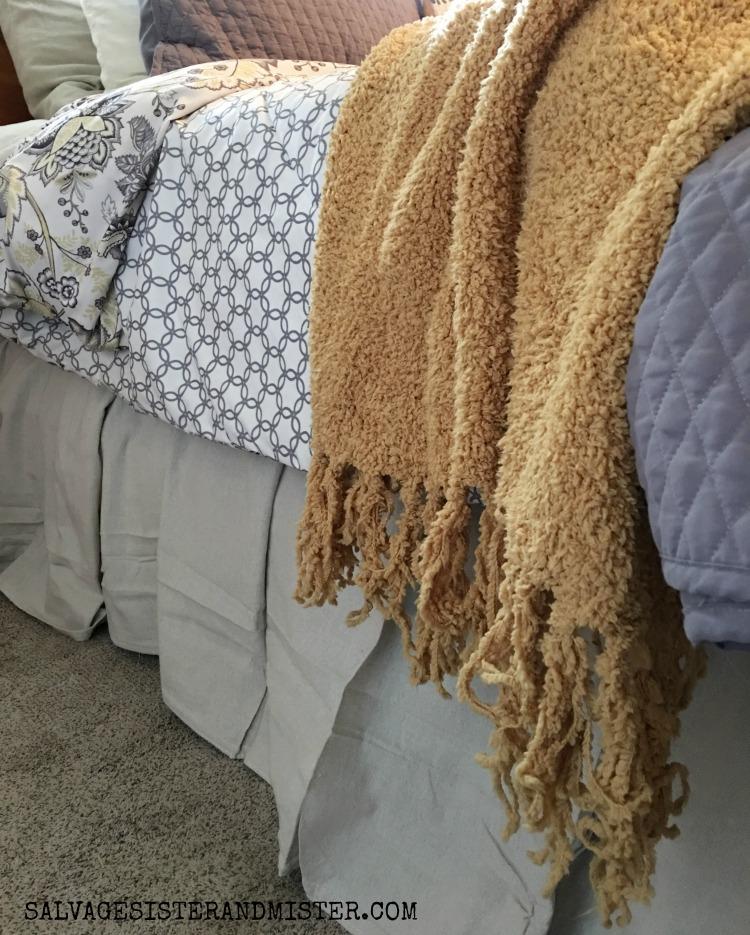 Making a DIY no sew drop cloth bed skirt #bargaindecor #budgetdecorating #dropclothdiy #bedroomdecor