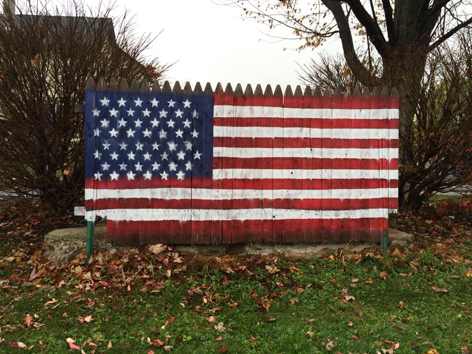 Flag fence that hides the garbage cans #ucpycle #flag #americanflag