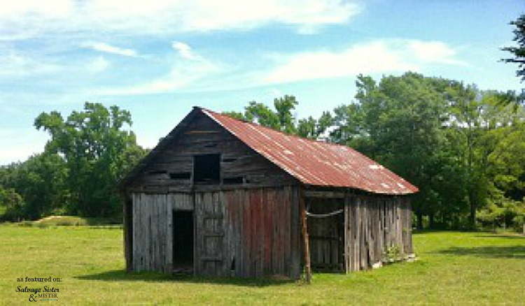 120 year old barn on property of this country home with a farmhouse makeover as featured on salvagesisterandmister.com