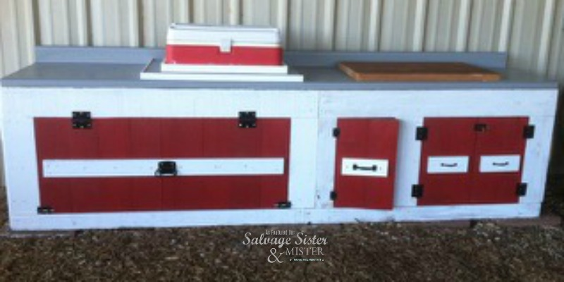 Creating a dog area with an old kitchen cabinet as featured on salvagesisterandmister.com