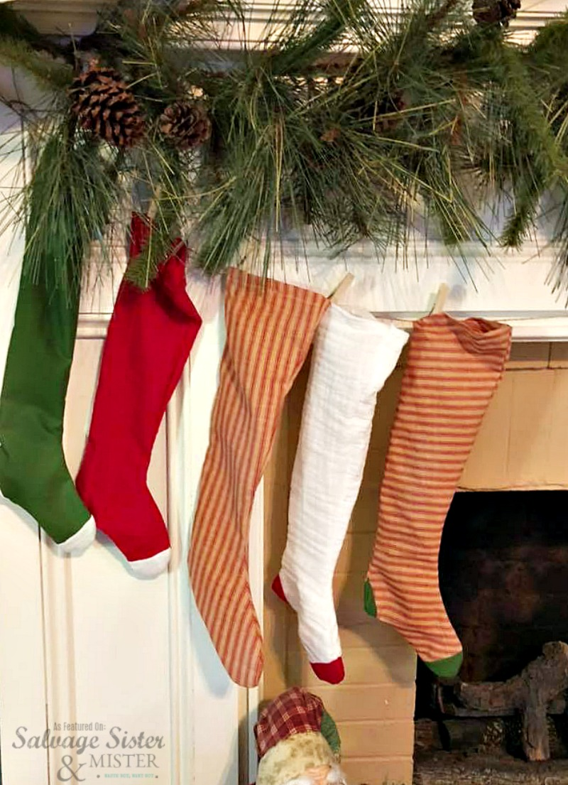 A retro Christmas with homemade stockings for the mantel. Feature on salvagesisterandmister.com #christmasstockings #christmasmatel #manteldecor