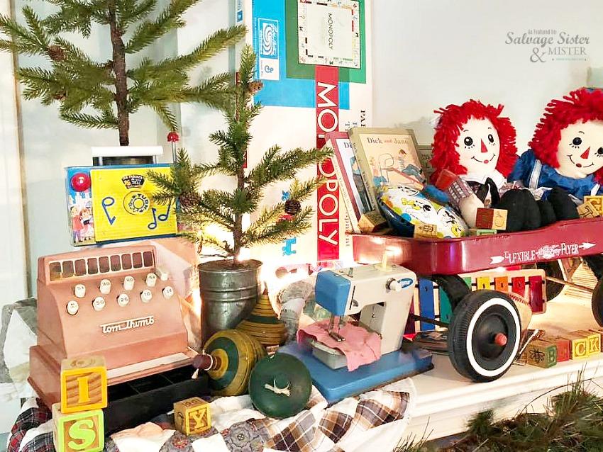 Using retro toys to create a unique vintage Christmas toy mantel fond on salvagesisterandmister.com #Christmasdecor #vintagechristmas #budgetchrustimas