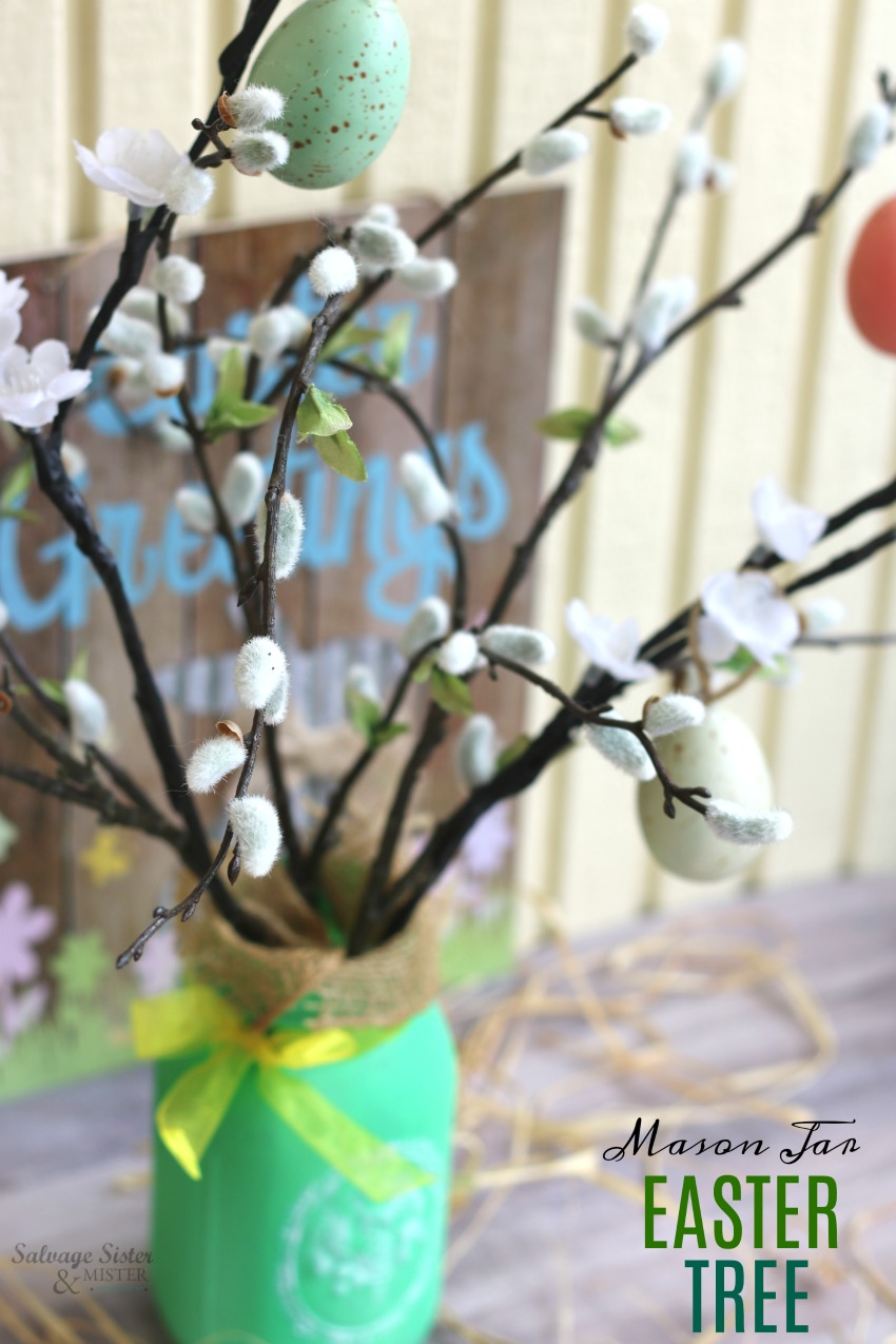 Take an old mason jar/spaghetti jar and turn it into a fun centerpiece - mason jar Easter tree centerpiece is quick and easy. You can use stuff you have on hand for this easy diy projects #reuse #masonjar #eastercraft on salvagesisterandmister.com